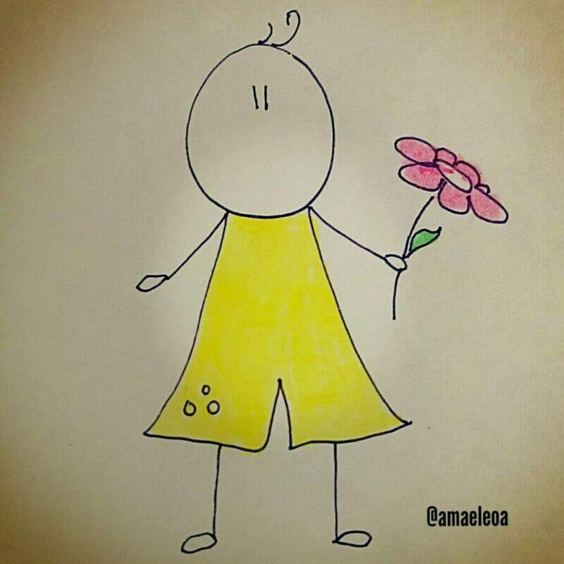 menino segurando uma flor