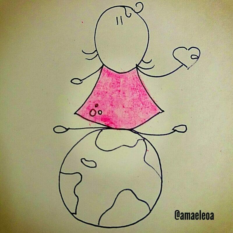 criança sentada sobre o globo terrestre
